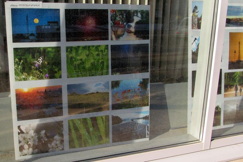 Фотовыставка в стеклах библиотеки - волга фото.